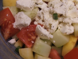 color photograph of goat cheese cucumber squash tomato salad (c) Katrien Vander Straeten