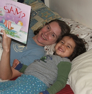 Mama and Amie reading a bedtime story