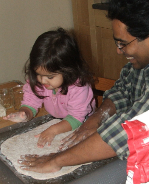 Amie and Baba making Pizza, Feb 2008 (c) Katrien Vander Straeten