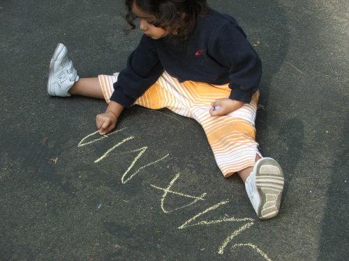 """Amie writes """"Mama"""", August 2008 (c) Katrien Vander Straeten"""