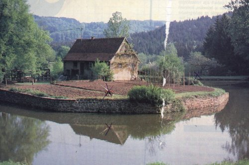 Photograph of small farm on river bend