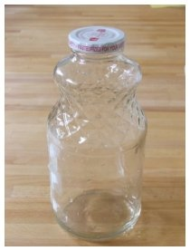photograph of glass lemonade bottle