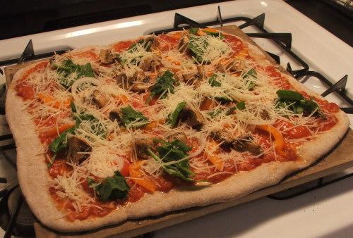 Amie and Baba's pizza, Feb 2008 (c) Katrien Vander Straeten