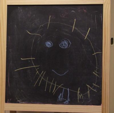 Amie's chalk drawing of sun, 7 August 2008 (c) Katrien Vander Straeten