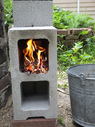 Earth oven phase 10 rocket stove robin hill gardens for Decorative rocket stove